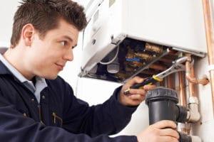 a plumber working on boiler repair in Hartford County, CT